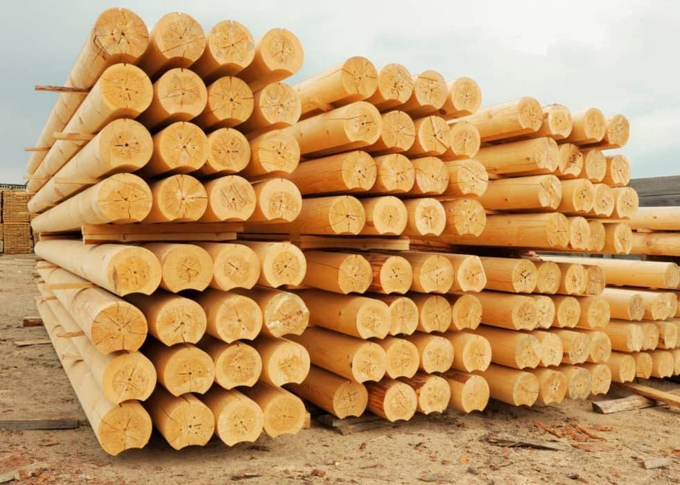 производство оцилиндрованного бревна, дома из цилиндрического бруса, брус цилиндрический цена